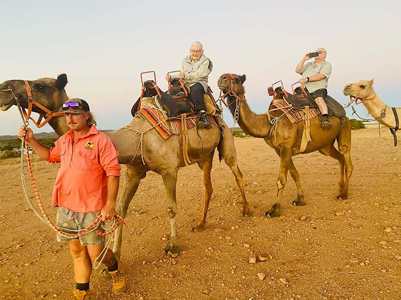 91 years old, and riding a camel in Silverton